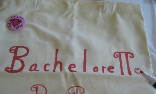 "Writing ""Bachelorette Party"" on the tote bag"